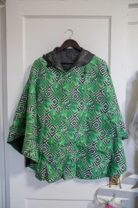 Singing in the Rain Reversible Poncho: Palm Party and Black $55.00